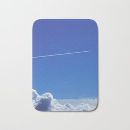 The trail of a flying airplane Bath Mat