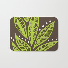 Floral tropical green leaves on brown background Bath Mat