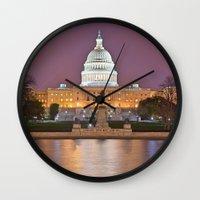 washington dc Wall Clocks featuring Glowing Washington DC Capitol by Nicolas Raymond