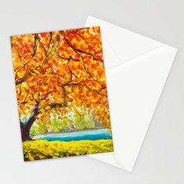 Big autumn tree near the river. Autumn landscape. Stationery Cards