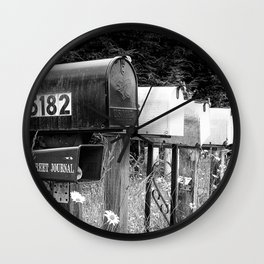 Black and white row of old road country us mailboxes Wall Clock