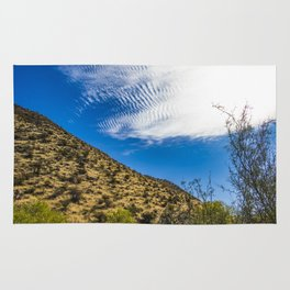 Clouds Stretching Across a Deep Blue Sky in the Anza Borrego Desert, California, USA Rug