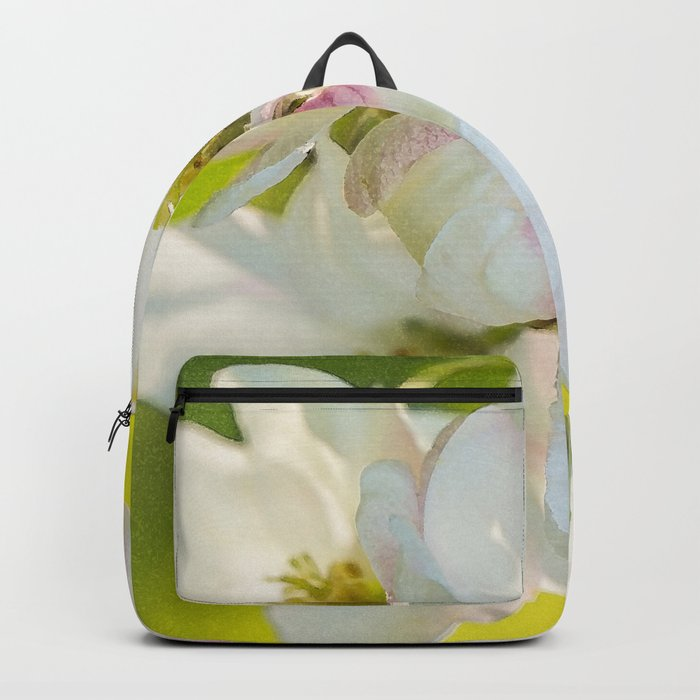 Close-up of Apple tree flowers on a vivid green background - Summer atmosphere Backpack