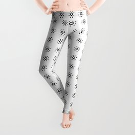MAGNOLIA mostly white pattern with small bursts of black Leggings