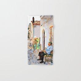 Borrello: senior citizen sitting on a bench outside the home Hand & Bath Towel