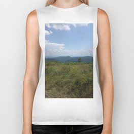 Meadow and mountains in the distance Biker Tank