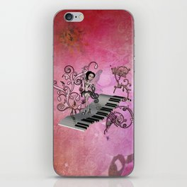 Cute fairy dancing on a piano iPhone Skin
