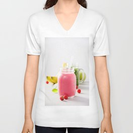 Close-up of pink fresh smoothie with fruits and berries selective focus. Unisex V-Neck