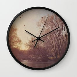 Birds take flight over lake on a winters morning. Wall Clock