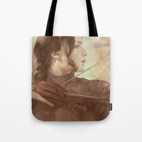 meme Tote Bags featuring MEME 018 Katniss Everdeen by mushroomtale