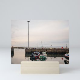 Fishing boats at dusk, docked in a small english harbour town. Mini Art Print