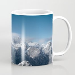 Clouds rolling above snowy mountains Coffee Mug
