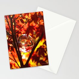 Red autumn foliage in the world of a globe Stationery Cards