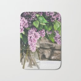 Romantic photo composition with lilac and vintage book on white lace tablecloth. Bath Mat