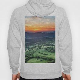 Beautiful sunset behind green fields Hoody