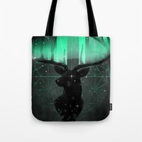 northern lights Tote Bags featuring Northern Lights by angrymonk