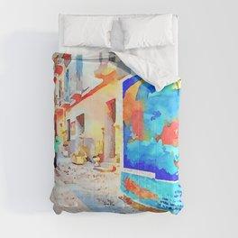 Man in the street with murals Comforters