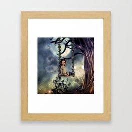 Cute little fairy with kitten on a swing Framed Art Print