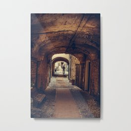 Silhouette of a man at the end of the tunnel in a medieval city Metal Print