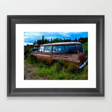 Old car resting in a field Framed Art Print