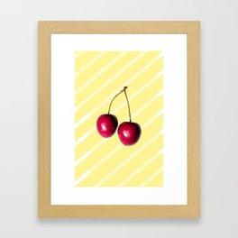 Cherry on yellow Framed Art Print
