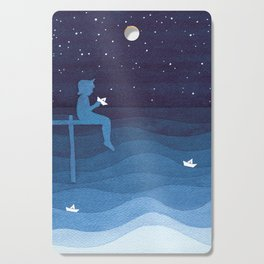 Boy with paper boats, blue Cutting Board
