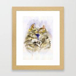Kittens hugging Framed Art Print