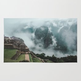 Ancient Inca ruins of Machu Picchu and surrounding Andes mountains on a misty morning Rug
