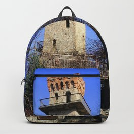 Ancient watchtower. Backpack