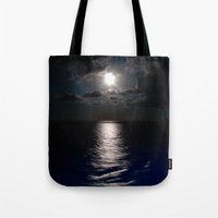 moonrise Tote Bags featuring Moonrise by Craig Treadwell