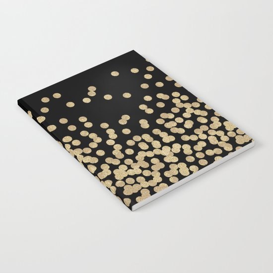 Gold glitter dots scattered on black background Notebook