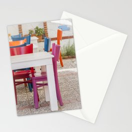 Colorful chairs and white tables Stationery Cards