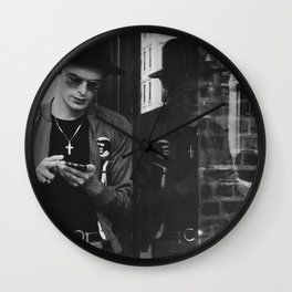 Young Man using Cell Phone, A Wall Clock