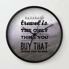Travel is the only thing you buy that makes you richer. Wall Clock