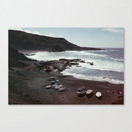 Boats on a beach Canvas Print