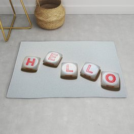 dice with letters make up the word smile Rug