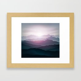dark blue mountain landscape with fog and a sunrise and sunset Framed Art Print