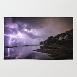 Dramatic lightning storm illuminates the sky Rug