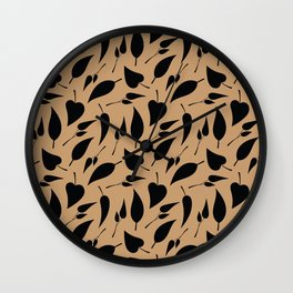 Black leaves on coffee brown background Wall Clock