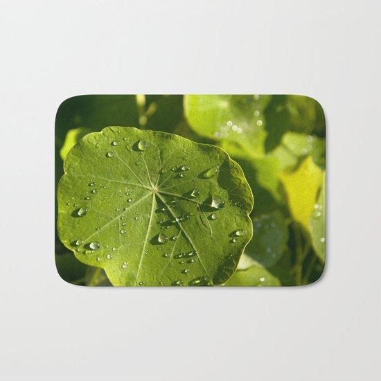 Rain drips on a nasturtium leaf Bath Mat