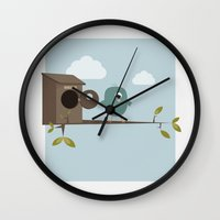 cyclops Wall Clocks featuring Cyclops bird by Emma S