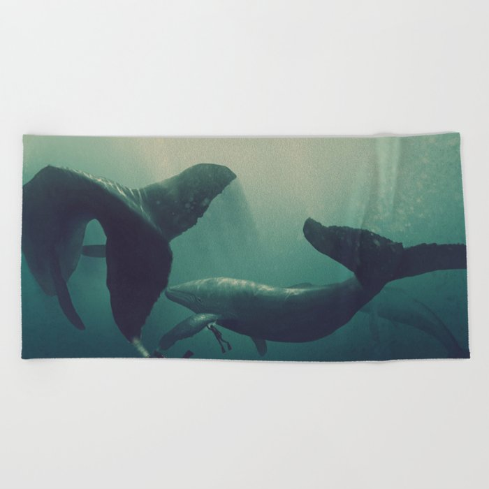 Swimming with whales Beach Towel