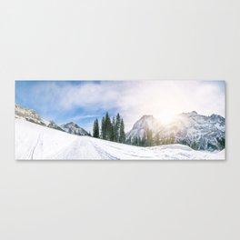 Alpine road through the snow Canvas Print