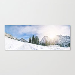 Alpine road through the snow Canvas Print