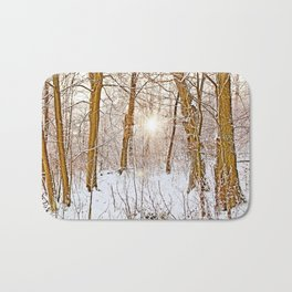 Sunshine in the snowy forest Bath Mat