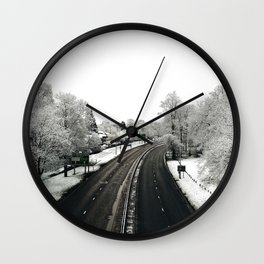 view from the walkway on a snowy day Wall Clock