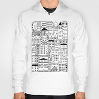 cityscape Hoodies featuring cityscape by Anna Grunduls