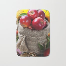 Burlap sack with apples on a wooden table Bath Mat