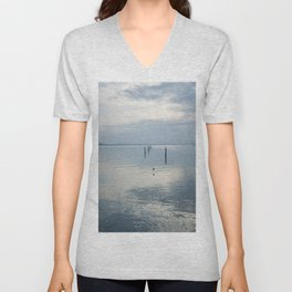 A blue lagoon and the water reflections Unisex V-Neck