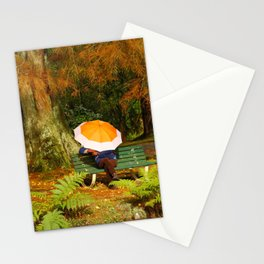 Woman sitting with umbrella Stationery Cards